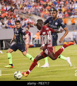 East Rutherford, USA. 25th July, 2018. Liverpool's Sadio Mane (front) shoots the ball during the International Champions Cup match between Manchester City and Liverpool FC in East Rutherford of New Jersey, the United States, July 25, 2018. Credit: Wang Ying/Xinhua/Alamy Live News - Stock Photo
