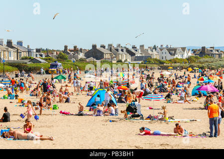 Troon, Ayrshire. 26th July 2018. UK Weather: Many take advantage of the unusually hot weather and take to the beach to cool off, sunbathe or take a swim in the sea. Credit: Findlay/Alamy Live News - Stock Photo