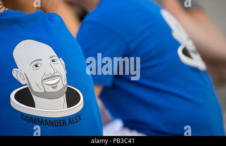 Kuenzelsau, Germany. 26th July, 2018. People wear t-shirts with astronaut Alexander Gerst's portrait on them as they watch a public video call with Gerst. Gerst is currently working on the International Space Station ISS. Credit: Sebastian Gollnow/dpa/Alamy Live News - Stock Photo