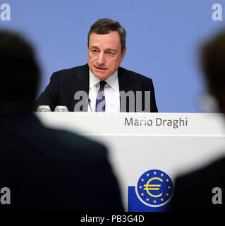 Frankfurt, Germany. 26th July, 2018. The European Central Bank (ECB) President Mario Draghi attends a press conference at the ECB headquarters in Frankfurt, Germany, on July 26, 2018. The ECB Thursday decided to maintain the key interest rates for the euro area, expecting them to remain at their present levels at least through the summer of 2019. Credit: Luo Huanhuan/Xinhua/Alamy Live News - Stock Photo