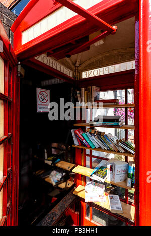 A Traditional Red Telephone Box Converted To A Village Library, Fairwarp, Sussex, UK - Stock Photo