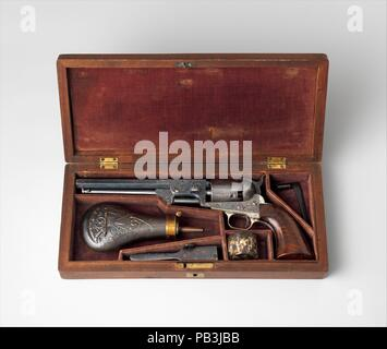 Colt Model 1851 Navy Percussion Revolver, Serial Number 29705, with Case and Accessories. Culture: American, Hartford, Connecticut. Dimensions: L. of pistol 13 in. (33 cm); L. of barrel 7 1/2 in. (19 cm); Cal. .36 in. (9 mm); case: 14 1/4 x 6 3/8 x 2 1/4 in. (36.2 x 16.2 x 5.6 cm). Engraver: Engraved by Gustave Young (American (born Prussia), 1827-1895 Springfield, Massachusetts). Manufacturer: Samuel Colt (American, Hartford, Connecticut 1814-1862). Date: ca. 1853-54.  Gustave Young (1827-1895), a German-born craftsman, engraved firearms with intricate and elaborate ornament for Colt in Hartf - Stock Photo