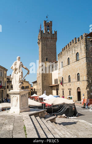 A statue in front of the Palazzo communale, the town hall of the medieval city of Arezzo, Tuscany, Italy - Stock Photo