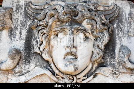Stone carved Medusa head at Apollo Temple at Didyma in Didim,Aydin,Turkey - Stock Photo