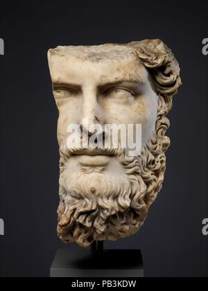 Marble portrait of the co-emperor Lucius Verus. Culture: Roman. Dimensions: H. 14 1/2 in. (36.8 cm). Date: A.D. 161-169.  This fragmentary head comes from an over-life-sized portrait bust or statue of Lucius Verus, co-emperor with Marcus Aurelius (r. A.D. 161-180). At the beginning of his reign, Verus was sent to the East to direct military operations against the Parthians, and although the war was concluded successfully in A.D. 166, his returning troops brought back the plague, which ravaged the Empire for several years thereafter. He is compared unfavorably with Marcus Aurelius by the ancien - Stock Photo