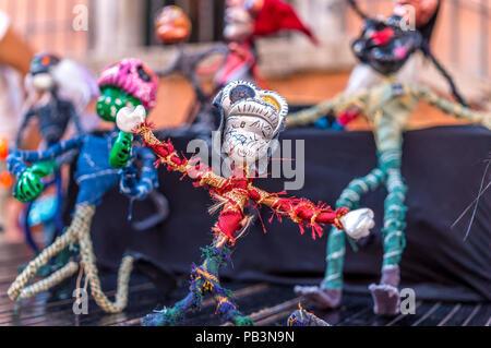 Colourful stick figurines representing Dia de los Muertos characters