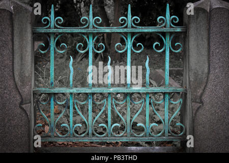A gate turned turquoise by age in Brompton Cemetery, London, England, UK, Europe. - Stock Photo