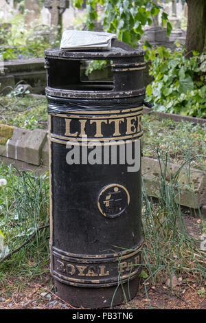 An iconic litter bin in Brompton Cemetary. - Stock Photo