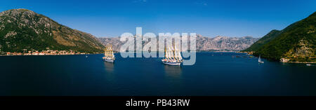 Aerial panoramic view of a two large yachts that swims in the Kotor bay. - Stock Photo