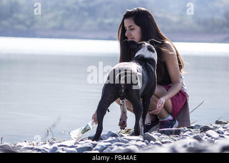 Girl Playing with her dog - Stock Photo