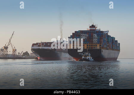 The Departing Container Ship KOTA CAHAYA, Passes Close To The Arriving YANG MING YM UNANIMITY In The Busy Los Angeles Main Channel, California, USA. - Stock Photo