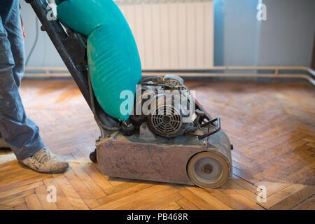 Home renovation, parquet sanding, polishin - Stock Photo