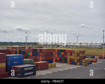 Looking across the Container Port and on to the Bulk Liquid Storage Tanks at Amsterdam Marine Terminal in the Netherlands. - Stock Photo