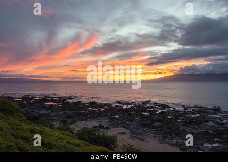 Napili Sunset between Lanai and Molokai - Stock Photo