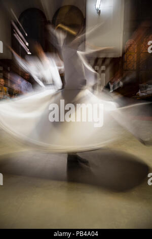 Dancers, whirling dervishes ceremony, Sirkeci Train Station, Istanbul, Turkey - Stock Photo