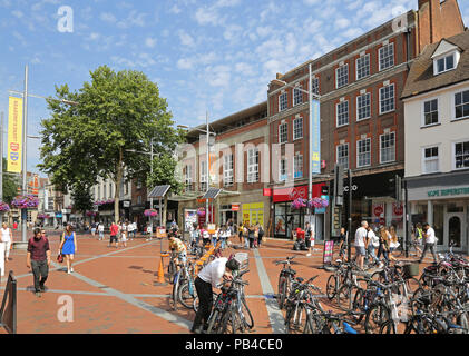 Reading town centre, Berkshire. Pedestrianised section of Broad Street. Shows shoppers, pedestrians and parked bicycles - Stock Photo