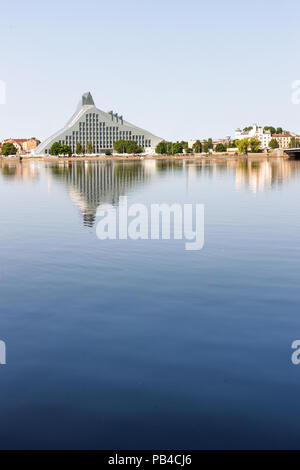 The building of the new National Library in Riga on the Daugava River with reflection - Stock Photo
