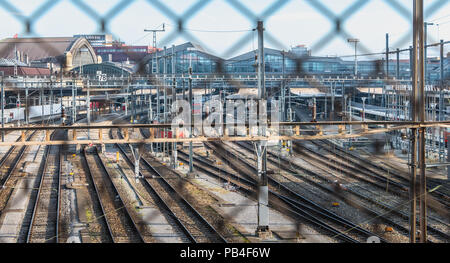 Basel, Switzerland - December 25, 2017: view of the Basel train station and its platforms in front of which trains are stopped on a winter day - Stock Photo