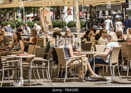 Wolfsburg, Lower-Saxony, Ger,any, July 1st 2018: Cafe occupied by many people in the pedestrian zone during a city festival - Stock Photo