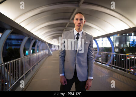 Young Handsome Businessman Outdoors At Night - Stock Photo