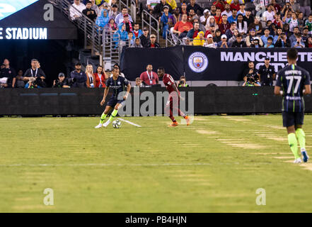 East Rutherford, United States. 25th July, 2018. Leroy Sane (19) of Manchester City controls ball during ICC game against Liverpool FC at MetLife stadium Liverpool won 2 - 1 Credit: Lev Radin/Pacific Press/Alamy Live News - Stock Photo