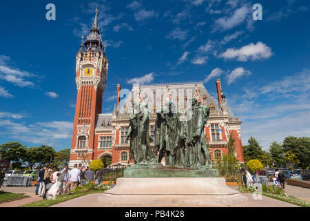Calais, France - 16 June 2018: Flemish and Neo-Renaissance City Hall and Auguste Rodin 6 Bourgeois sculpture. - Stock Photo