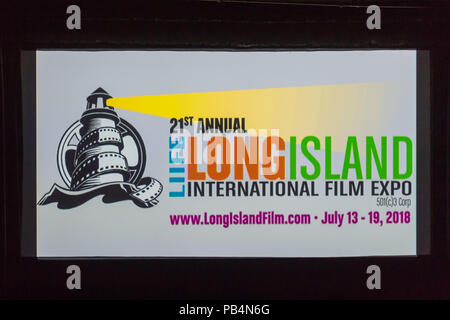 Bellmore, New York, USA. July 18, 2018. At start of final block of film screenings for the 21st Annual LIIFE Long Island International Film Expo, the LIIFE lighthouse and film reel logo and information fill the screen at the Bellmore Movies, the LIIFE location. LIIFE is a nonprofit 501(c)3 Corporation. - Stock Photo