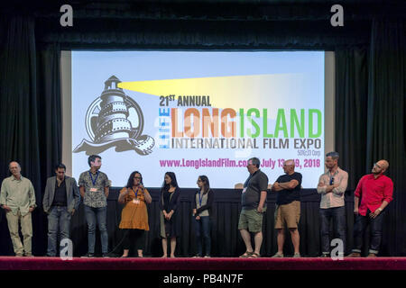 Bellmore, New York, USA. July 18, 2018. After final block of film screenings at LIIFE 2018, the Long Island International Film Expo, filmmakers and actors go on stage for Q&A at Bellmore Movies. SHARA ASHLEY ZEIGER, speaking into mic, is producer and writer of romcom short film JOE; right of her are AJNA JAI, who plays title character in The Adventures of Penny Patterson; and STEPHANIE DONNELLY, writer and director of that film. - Stock Photo