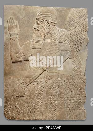 Relief panel. Culture: Assyrian. Dimensions: 64 x 49 1/2 x 4 1/2 in. (162.6 x 125.7 x 11.4 cm). Date: ca. 883-859 B.C..  This panel from the Northwest Palace at Nimrud (ancient Kalhu) depicts a winged supernatural figure. Such figures appear throughout the palace, sometimes flanking either the figure of the Assyrian king or a stylized 'sacred tree.' The reliefs were painted, but today almost none of the original pigment survives. However, the reliefs themselves retain incredible detail, including intricate incised designs on many of the figures' clothing.  The protective figure on this panel o - Stock Photo