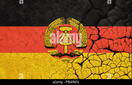 A Cracked And Fragile Flag Of German Democratic Republic - Stock Photo