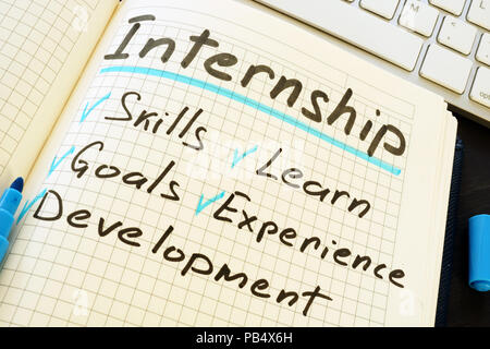 Internship and list of pros written in the notepad. - Stock Photo