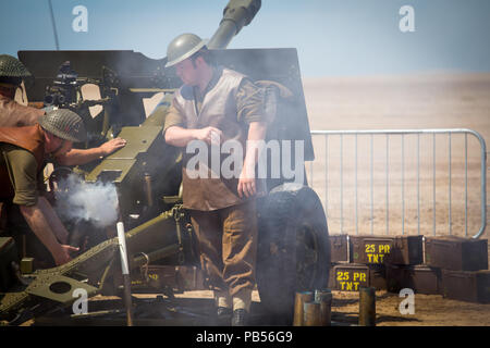 Anti-aircraft flak cannon being prepped and fired by British Military personnel taking part in the 2018 Southport Airshow - Stock Photo