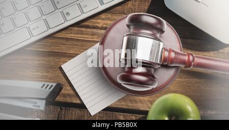 Gavel and keyboard on desk