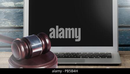 Gavel and laptop on desk - Stock Photo