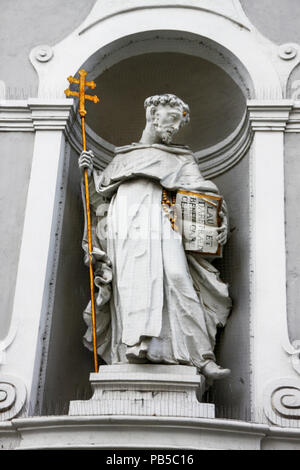Statue in the exterior niche of St Michael 18th century church in Budapest, Hungary - Stock Photo
