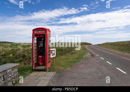 Lonely Red Phone Booth Telephone Box in Scotland UK - Stock Photo