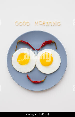 two beautiful eggs on a plate - Stock Photo