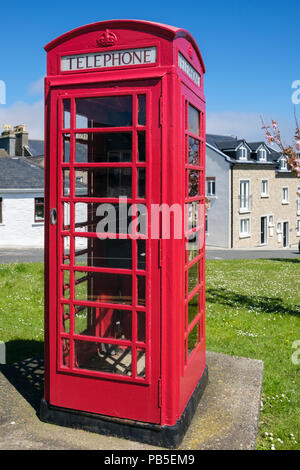 Traditional British K6 red telephone box still in use in Port St Mary, Isle of Man, British Isles, Europe - Stock Photo