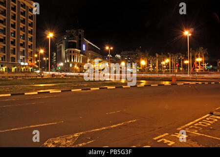 Night View on the Place d'Armes and Intendance Street in Port Louis, Mauritius, with the Caudan Waterfront in the background - Stock Photo