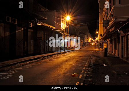 Night shot of Royal Road in Port Louis, Mauritius, towards the East - Stock Photo