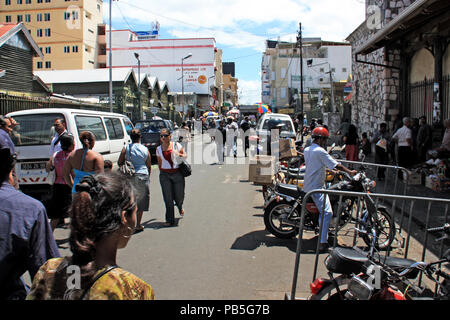 The commercial heart of Port Louis, Mauritius, where the old market is located left and right of this street in the huts visible on the left - Stock Photo