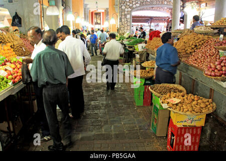 All kinds of vegetables for sale at a stall in the fruits and vegetables market hall in Port Louis, Mauritius - Stock Photo
