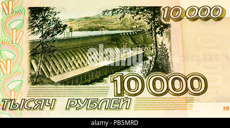 VELIKIE LUKI, RUSSIA - JULY 30, 2015: 10000 Russian ruble former bank note before 1997. RUble is the national currency of Russia - Stock Photo