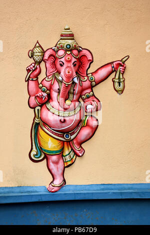 Colorful relief of Ganesha at a wall of a Hindu temple in Mauritius - Stock Photo