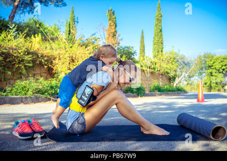 Mom and her son play sports a games in the park on sunny summer day, happy active childhood, good loving family concept - Stock Photo