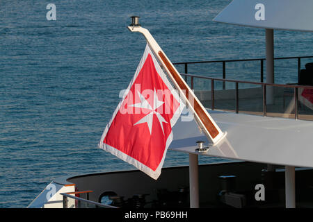 The merchant flag or civil ensign of Malta on the stern of a ship. Malta's maritime shipping register is one of the largest in the EU. - Stock Photo