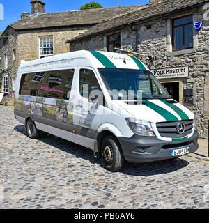 Grassington bus stop Venturer minibus serves Buckden Starbotton Kettlewell Kilnsey Long Ashes villages in Upper Wharfedale North Yorkshire England UK