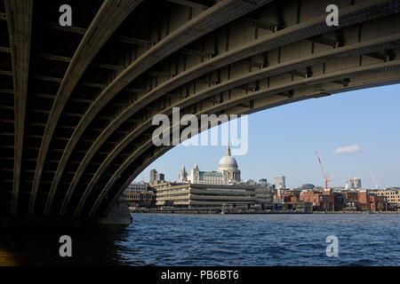 View of St Paul's Cathedral from underneath Blackfriars Bridge, River Thames, London - Stock Photo