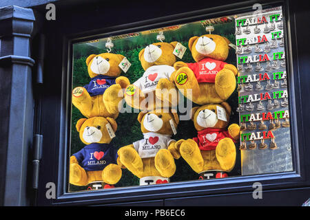 Milan, Italy - November 2, 2017: In the shop window of a souvenir shop, shows little teddy bears i love Milan and magnets Italy on a fall day - Stock Photo