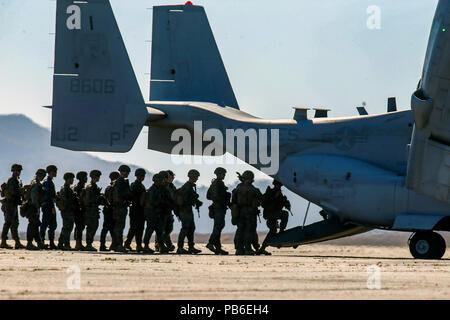 U.S. Marines with 2nd Battalion, 1st Marine Regiment, board an MV-22B Osprey tiltrotor aircraft - Stock Photo